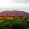 Uluru and green scrub