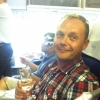 john-with-champers-business-class