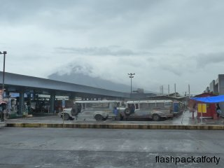 legapazi-bus-and-jeepney-terminal-with-volcano-under-clouds