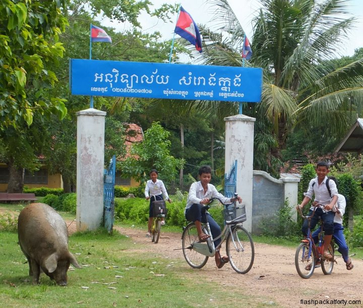 schoolkids-and-boar-battambang