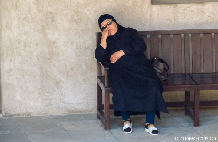 woman-snoozes-in-old-dubai