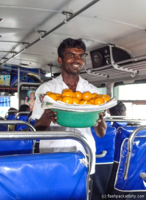 galle-bus-seller-with-oranges