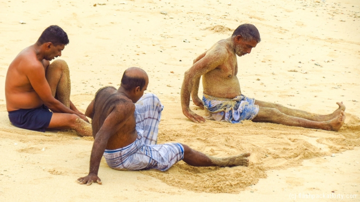 sand-washing-galle-fort-beach