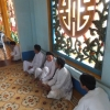 cao dai window and worshipers