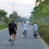 monks cycling hoi an