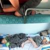 Vietnemese children asleep on train
