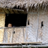 child-peeks-from-window-inle-lake