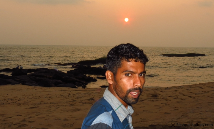 man-at-sunset-ezhara-beach