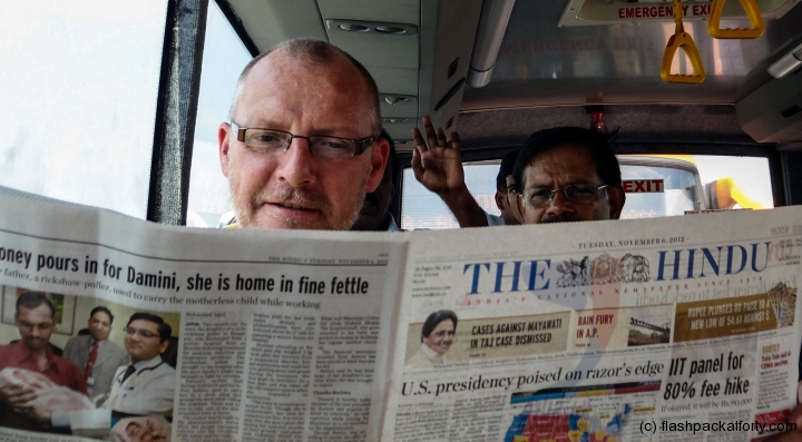 flashpacker-reading-indian-newspaper