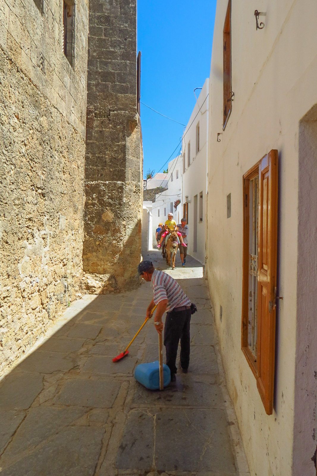 donkey-poo-cleaner-in-lindos-greece