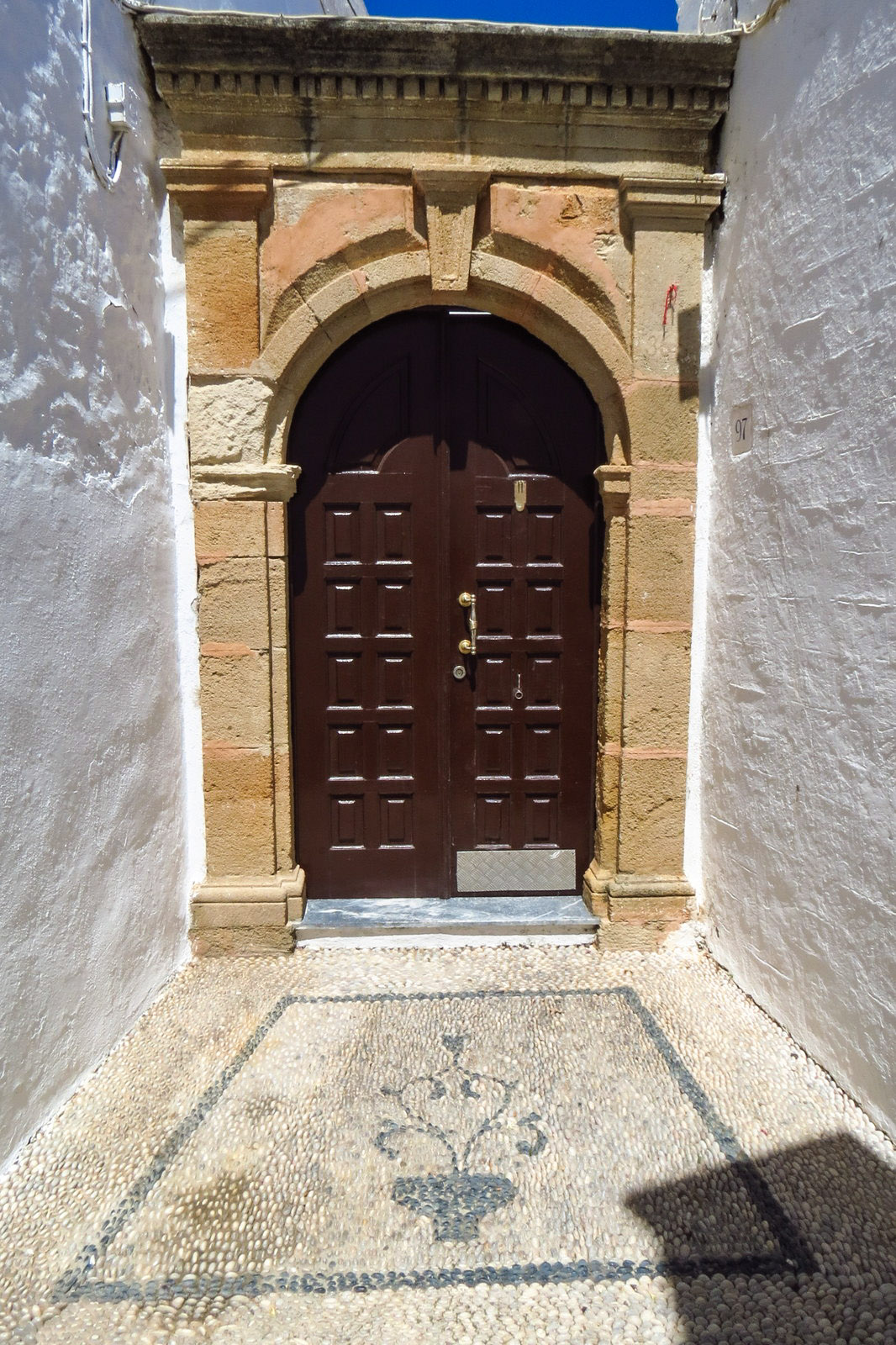 old-door-and-pebble-entrance-lindos