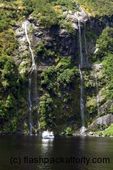 doubtful-sound-falls-small-boat