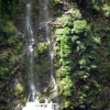 doubtful-sound-boat-and-waterfall
