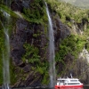 milford-sound-boat-waterfall