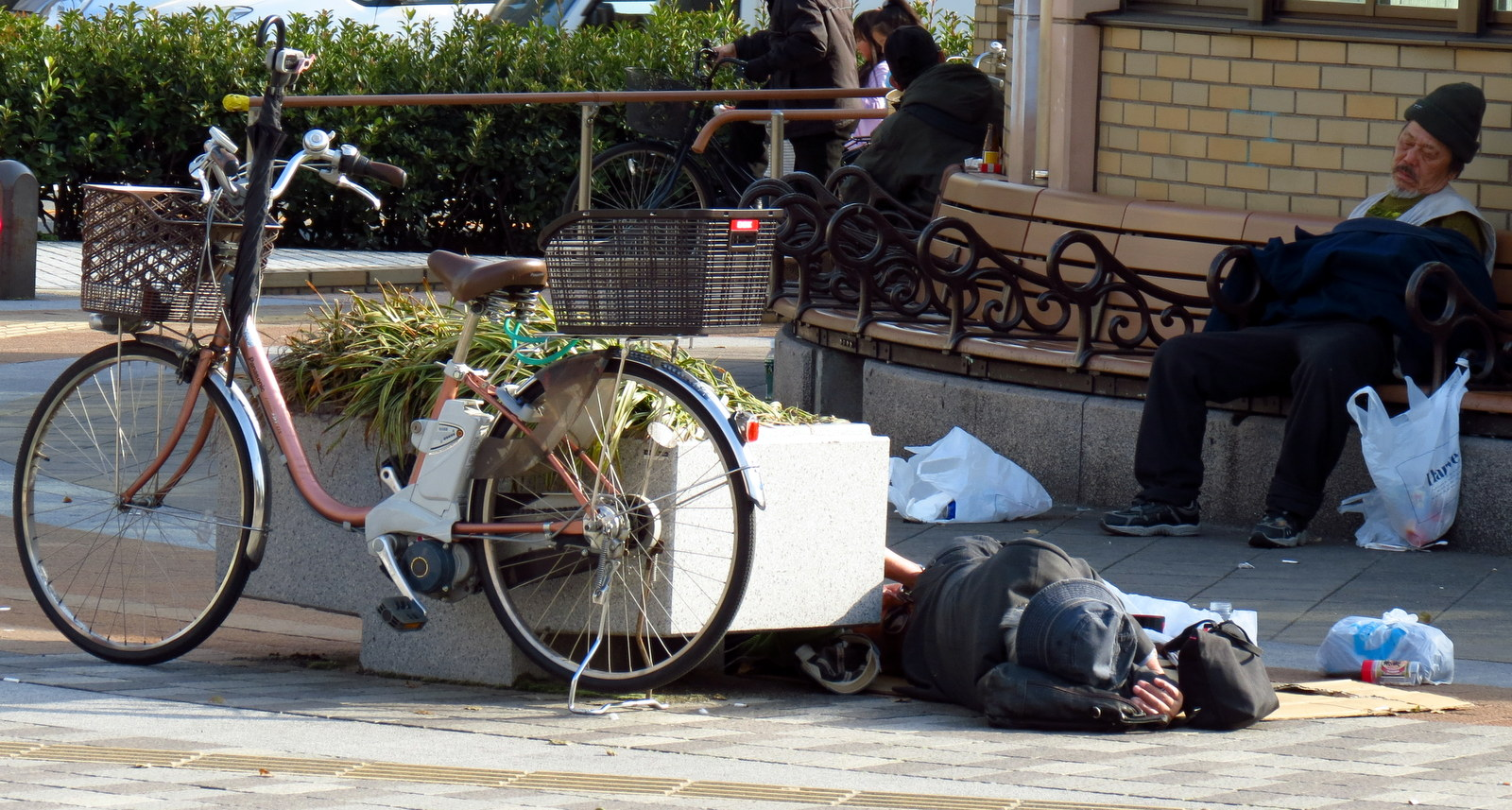 Japanese homeless person sleeping in the street Osaka