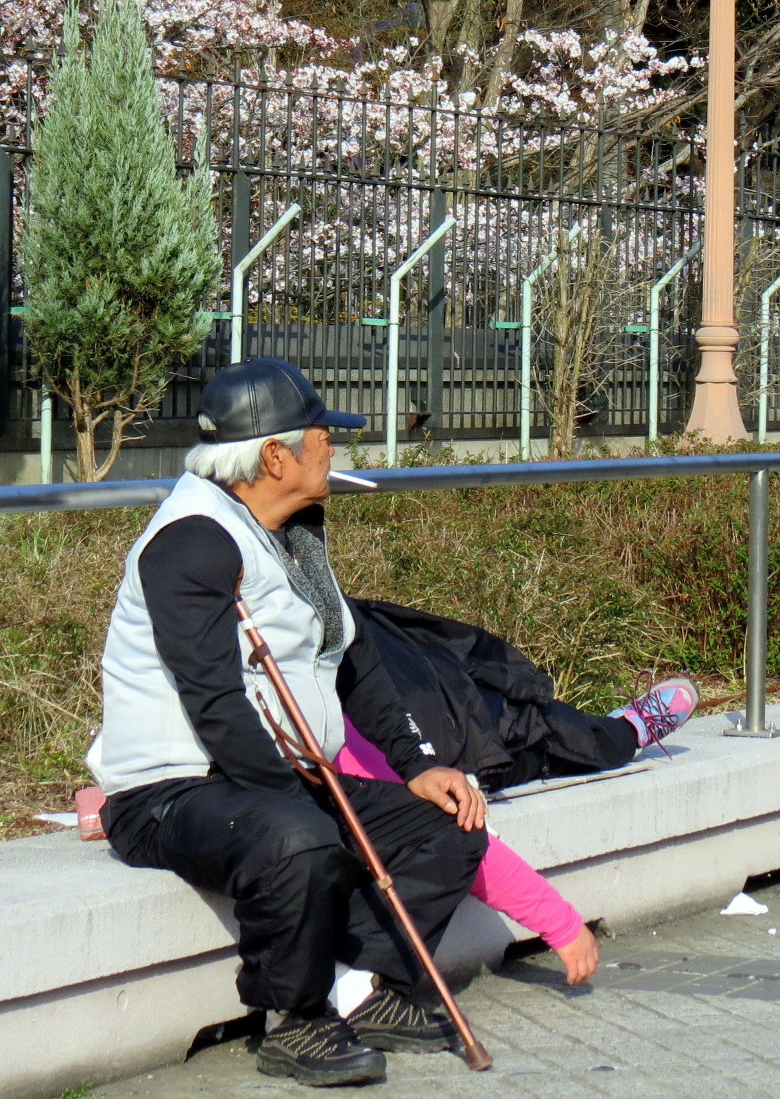Japanese man sitting on a bench Osaka