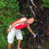john-fills-water-from-mountain-stream-pagudpud