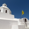white-church-and-flags-karterados-santorini