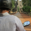 tuk-tuk-driver-approaches-south-gate-angkor-wat