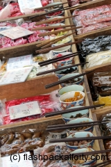 chopsticks-and-food-samples-in-japanese-market