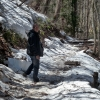 old-man-walking-up-a-snowy-path